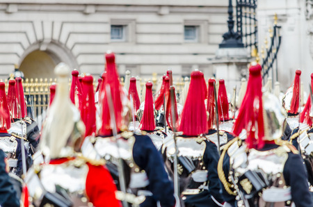 ceremonial clothing: LONDON - MAY 30:  The guard ceremony at Buckingham Palace on May 30, 2015 in London, which is one of Englands most popular visitor attractions.