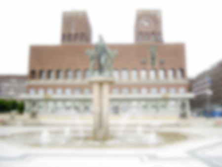 gildhall: Defocused Background on the City Hall, Oslo, Norway. Intentionally blurred post production for bokeh effect Stock Photo