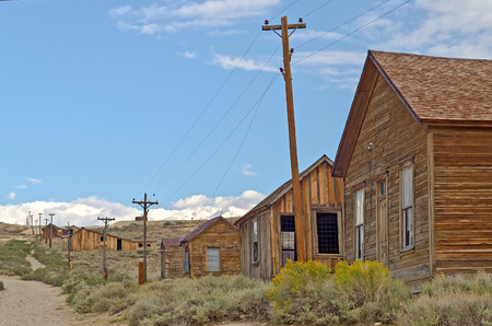 gold mining: Abandoned House in the Gold Mining Ghost Town of Bodie, State Historic Park in California, USA Stock Photo