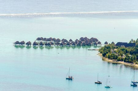 moorea: Overwater Bungalows on a tropical paradise beach in Moorea, French Polynesia