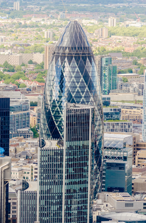 recognized: LONDON - MAY 29: The Gherkin building (30 St Mary Axe) in London on May 29, 2015. Iconic landmark of London, this is one of the citys most widely recognized examples of modern architecture. Editorial