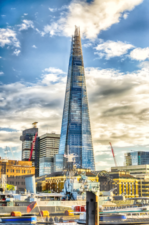 urbanism: LONDON - MAY 29: The Shard, iconic skyscraper in London, on May 29, 2015. It was designed by the Italian architect Renzo Piano and completed in 2013.