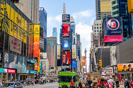 NEW YORK - CIRCA MAY 2013: Times Square, New York, circa May 2013. Times Square is a major commercial intersection, iconified as The Crossroads of the World, its the hub of the Broadway Theater District