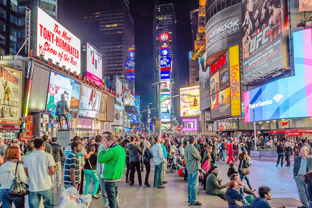 times square new york: NEW YORK - CIRCA MAY 2013: Times Square, New York, circa May 2013. Times Square is a major commercial intersection, iconified as The Crossroads of the World, its the hub of the Broadway Theater District