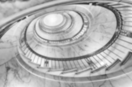 intentionally: Defocused background of a spiral staircase. Intentionally blurred post production for bokeh effect
