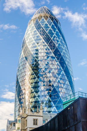 LONDON - MAY 29: The Gherkin building (30 St Mary Axe) in London on May 29, 2015. Iconic landmark of London, this is one of the city's most widely recognized examples of modern architecture.