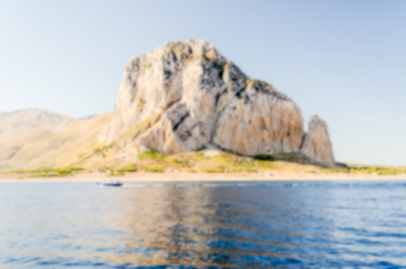 capo: Defocused background with view of San Vito Lo Capo, Italy. Intentionally blurred post production for bokeh effect