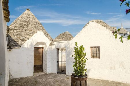 conical: Typical trulli buildings with conical roofs in Alberobello, Apulia, Italy