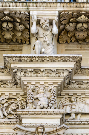 Sculpture on the facade of the Church of the Holy Cross in Lecce. Masterpiece of baroque art in Salento, Apulia, Italy