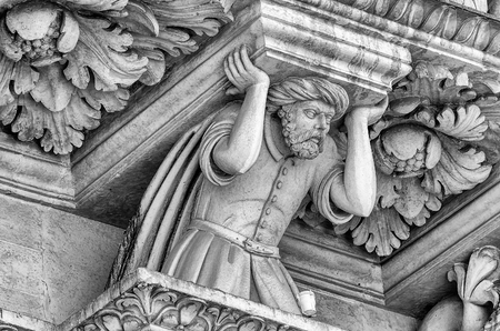 telamon: Sculpture on the facade of the Church of the Holy Cross in Lecce. Masterpiece of baroque art in Salento, Apulia, Italy
