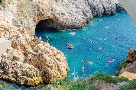 Beautiful scenic seascape at Ciolo Bridge, near Santa Maria di Leuca, Salento, Apulia, Italy 写真素材