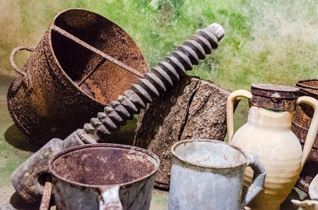 oil mill: Rusty tools in an ancient underground oil mill in Salento, Italy Stock Photo