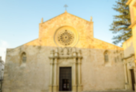architectural architectonic: Defocused background with facade of the Otranto Cathedral, iconic landmark in Salento, Italy. Intentionally blurred post production for bokeh effect Stock Photo