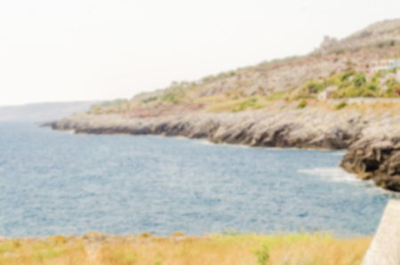 intentionally: Defocused background with beautiful seascape in Salento, Apulia, Italy. Intentionally blurred post production for bokeh effect Stock Photo