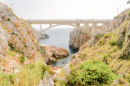 santas village: Defocused background of scenic seascape at Ciolo Bridge, Apulia, Italy. Intentionally blurred post production for bokeh effect