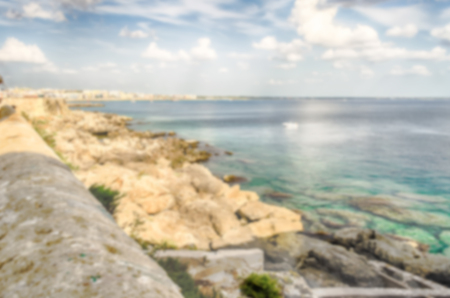 mediterranea: Defocused background with Scenic view of Gallipoli waterfront, Salento, Italy. Intentionally blurred post production for bokeh effect Stock Photo