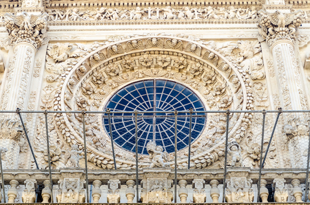 architectural architectonic: Baroque scenic rose window, detail of the church of the Holy Cross. Lecce, Salento, Italy Stock Photo