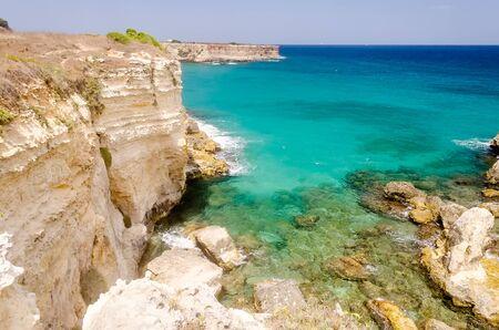 sea cliff: Scenic view of the rocky cliffs in Torre Sant Andrea town, Salento, Apulia, Italy Stock Photo