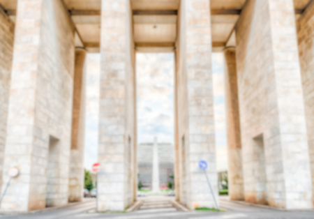 rationalism: Defocused background of neoclassical architecture in EUR district, Rome, Italy. Intentionally blurred post production for bokeh effect