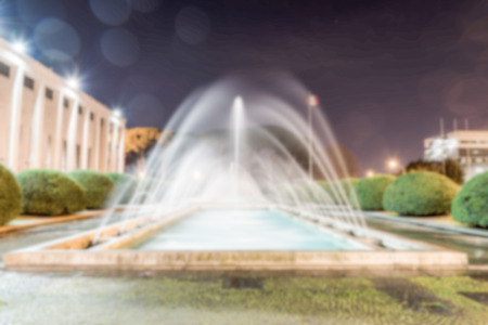 borne fontaine: Defocused background of neoclassical fountain in Rome, Italy. Intentionally blurred post production for bokeh effect Banque d'images