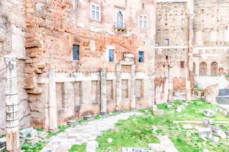 augustus: Defocused background with Forum of Augustus, ruins in via dei Fori Imperiali, Rome, Italy. Intentionally blurred post production for bokeh effect Stock Photo