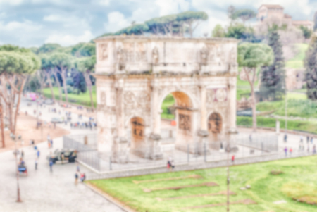 constantine: Defocused background with Arch of Constantine in Rome, Italy. Intentionally blurred post production for bokeh effect Stock Photo