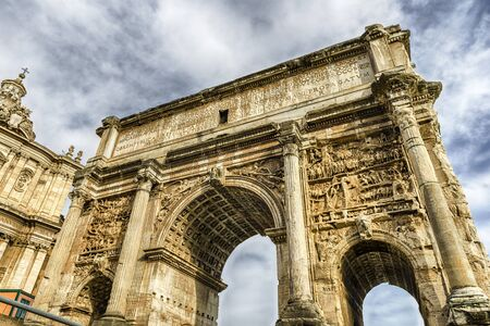 severus: Triumphal Marble Arch of Septimius Severus on the Capitoline Hill, Roman Forum, Rome, Italy