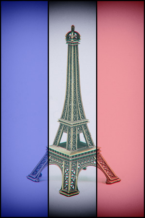 french model: Eiffel Tower model on french flag. Dust and scratches applied for vintage analog effect