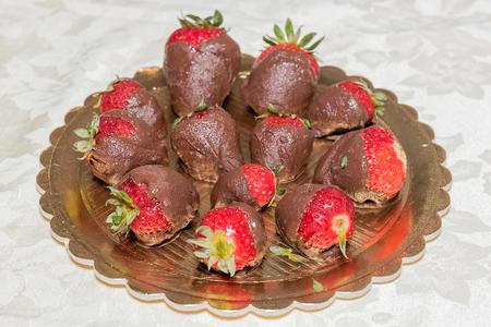 chocolate covered strawberries: Homemade Chocolate Covered Strawberries on a golden plate for Valentines Day Stock Photo