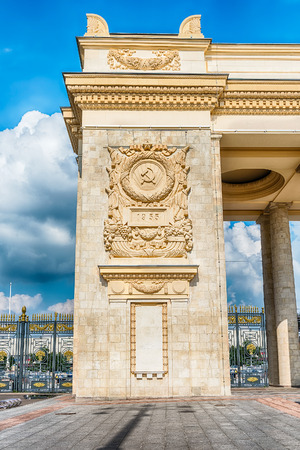 Soviet symbols, part of the bas-relief on the main entrance gate of Gorky Park, Moscow Stock Photo