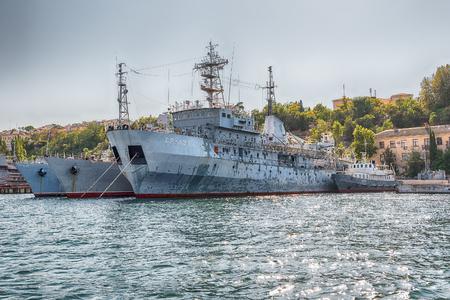 SEVASTOPOL, CRIMEA - AUGUST 24, 2016: Soviet and Russian Black Sea Fleet warships, standing in the quay of the Sevastopol bay, Crimea