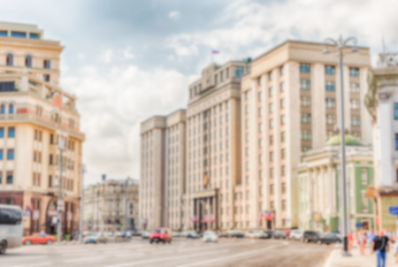 duma: Defocused background of the State Duma, Parliament building of Russia. Intentionally blurred post production for bokeh effect Stock Photo