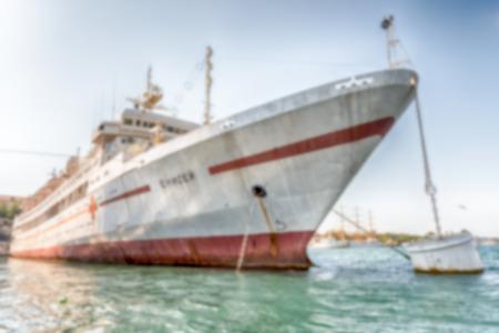 pygocentrus: Defocused background with Black Sea Fleet warships in Sevastopol, Crimea. Intentionally blurred post production for bokeh effect