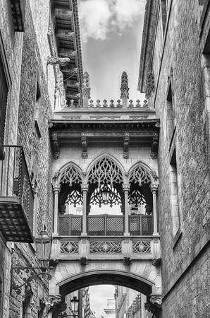 Neogothic bridge in Carrer del Bisbe, scenic street in the Gothic Quarter of Barcelona, Catalonia, Spain