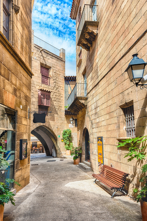 montjuic: Scenic alley inside Poble Espanyol, an open-air architectural museum on the Montjuic hill in Barcelona, Catalonia, Spain Stock Photo