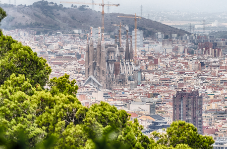 BARCELONA - AUGUST 11: Aerial view of Sagrada Fami­lia, the most iconic landmark in Barcelona, Catalonia, Spain, on August 11, 2017. Designed by A. Gaudi is estimated to be completed by 2026 - 2028 Editorial