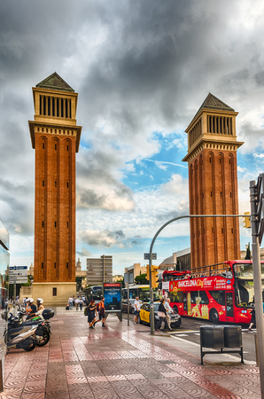 BARCELONA - AUGUST 11: Venetian Towers on Avinguda de la Reina Maria Christina, Barcelona, Catalonia, Spain, on August 11, 2017. The towers are modeled on Bell Tower of St. Mark Basilica in Venice