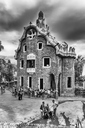 BARCELONA - AUGUST 9: Gingerbread house, modernist building at the entrance of Park Guell in Barcelona, Catalonia, Spain, on August 9, 2017.  Designed by Antoni Gaudi, the park opened in 1926