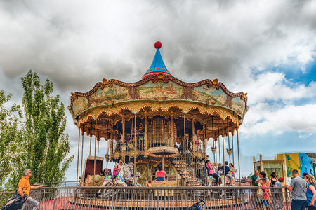 BARCELONA - AUGUST 12: Vintage carousel at Tibidabo Amusement Park, Barcelona, Catalonia, Spain on August 12, 2017. The park opened in 1905 and is among the oldest in the world still functioning
