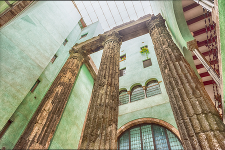 BARCELONA - AUGUST 8: Ancient ruins of roman columns at the Temple of Augustus in Barcelona, Catalonia, Spain, on August 8, 2017 Sajtókép