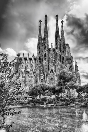 sagrada: BARCELONA - AUGUST 9: View of the Sagrada Familia, iconic landmark in Barcelona, Catalonia, Spain, on August 9, 2017. Designed by Gaudi and estimated to be completed by 2028. Cranes digitally removed