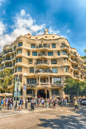 BARCELONA - AUGUST 9: Facade of the modernist masterpiece Casa Mila, aka La Pedrera, renowned building designed by Antoni Gaudi and iconic landmark in Barcelona, Catalonia, Spain, on August 9, 2017