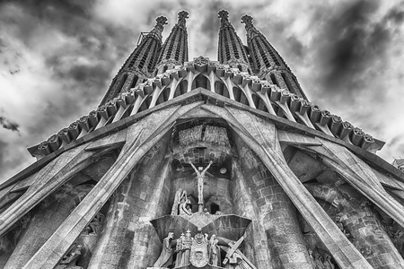 BARCELONA - AUGUST 9: The Passion Facade of the Sagrada Familia, the most iconic landmark designed by Antoni Gaudi in Barcelona, Catalonia, Spain, as seen on August 9, 2017. Cranes digitally removed