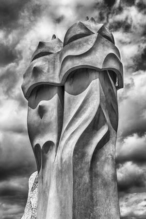 BARCELONA - AUGUST 9: Iconic chimneys, aka witch scarers, at the modernist Casa Mila, aka La Pedrera, renowned building designed by Antoni Gaudi. Barcelona, Catalonia, Spain, on August 9, 2017 Editorial