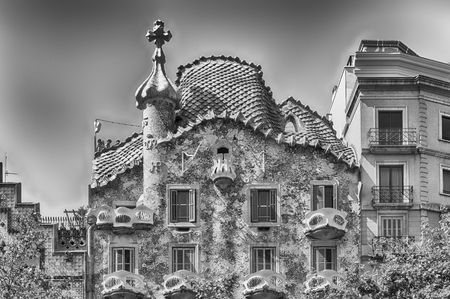 BARCELONA - AUGUST 9: Facade and Dragons tile rooftop of Casa Batllo, renowned building designed by Antoni Gaudi and iconic landmark in Barcelona, Catalonia, Spain, on August 9, 2017 Editorial
