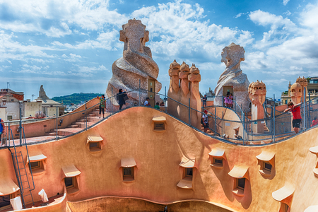 BARCELONA - AUGUST 9: The scenic architecture on the rooftop of Casa Mila, aka La Pedrera, designed by Antoni Gaudi and iconic landmark in Barcelona, Catalonia, Spain, on August 9, 2017