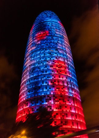 BARCELONA - AUGUST 11: Torre Glories, formerly Agbar, by night in Barcelona, Catalonia, Spain, on August 11, 2017. The tower is a 38-story skyscraper located in the technological district of Barcelona