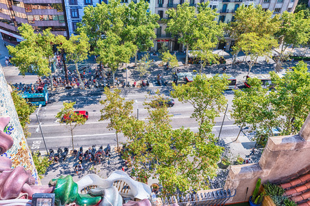 BARCELONA - AUGUST 9: Aerial view of Passeig de Gracia in the Eixample district of Barcelona, Catalonia, Spain, on August 9, 2017. It is one of the major avenues and shopping street of the city