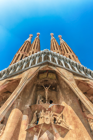 sagrada: BARCELONA - AUGUST 9: The Passion Facade of the Sagrada Familia, the most iconic landmark designed by Antoni Gaudi in Barcelona, Catalonia, Spain, as seen on August 9, 2017. Cranes digitally removed