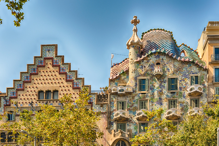 BARCELONA - AUGUST 9: Rooftops of the modernist masterpieces Casa Batllo and Casa Amatller, iconic landmarks in Passeig de Gracia, Eixample district of Barcelona, Catalonia, Spain, on August 9, 2017 Reklamní fotografie - 88010677